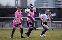 (l-r) Madison (left) (Alien Uncovered), Shae (Alien Uncovered) & AJ AZARI (Aimee Jade) (Creative Artist / Winner of STEPPING OUT UK) and partner of JLS Singer Oritse Williams watch the ball during the SOCCER SIX Celebrity Football Event at the Queen Elizabeth Olympic Park, London, England on 26 March 2016. Photo by Andy Rowland.