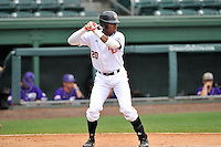 Center fielder Kyle Lewis (20) of the Mercer Bears bats against Western Carolina in Game 1 of the SoCon Tournament championship series on Sunday, May 29, 2016, at Fluor Field at the West End in Greenville, South Carolina. Western won, 4-2. (Tom Priddy/Four Seam Images)