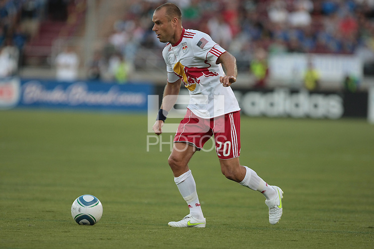 New York Red Bulls midfielder Joel Lindpere (20) controls the ball. The San Jose Earthquakes tied the New York Red Bulls 2-2 at Stanford Stadium in Stanford, California on July 2nd, 2011.