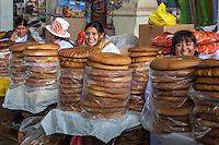 Peru, Cusco, San Pedro Market.  Peruvian Women Selling Bread.