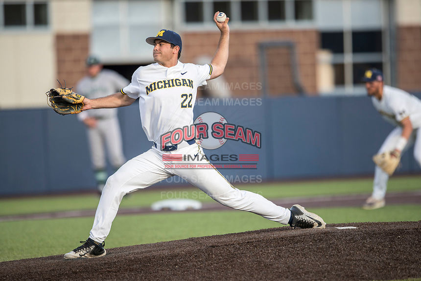 Michigan Wolverines pitcher William Tribucher (22) delivers a pitch to the plate during the NCAA baseball game against the Eastern Michigan Eagles on May 16, 2017 at Ray Fisher Stadium in Ann Arbor, Michigan. Michigan defeated Eastern Michigan 12-4. (Andrew Woolley/Four Seam Images)