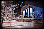 Moody shot of snowy night Downtown Dayton Ohio of Old Courthouse at Courthouse Plaza