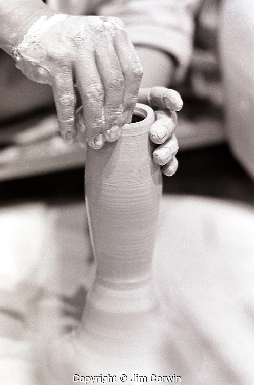 Close-up on potter hands making pottery
