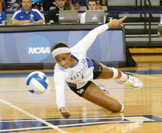 Whitney Billings of the UK Women's Volleyball team digs the ball against Arkansas on 11/20/11 in Lexington, Ky. Photo by Quianna Lige | Staff