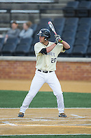 Justin Yurchak (20) of the Wake Forest Demon Deacons at bat against the UConn Huskies at Wake Forest Baseball Park on March 17, 2015 in Winston-Salem, North Carolina.  The Demon Deacons defeated the Huskies 6-2.  (Brian Westerholt/Four Seam Images)