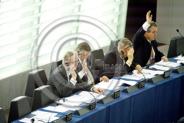 STRASBOURG - FRANCE - 22 APRIL 2004--The MEPs Samuli POHJAMO(L) and Mikko PES?L?(M) (Pesala) and 2 unknown persons, from the Group of the European Liberal, Democrat and Reform Party in the European Parliament in Strasbourg.-- PHOTO: ERIK LUNTANG / EUP-IMAGES