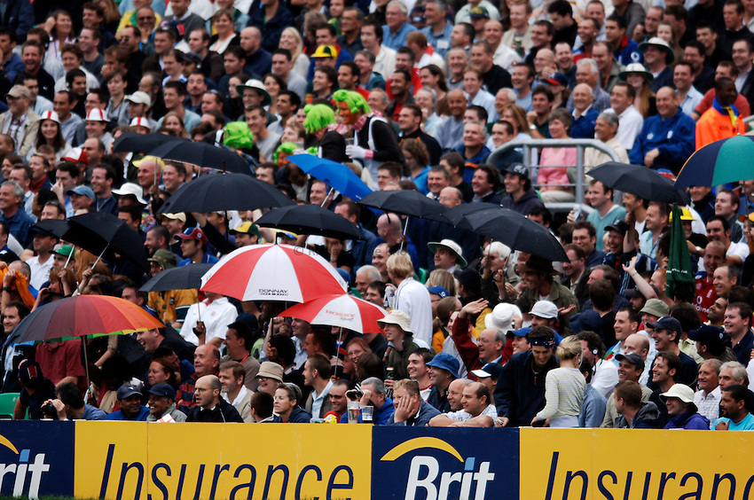 Photo: Glyn Thomas..England v Australia. nPower Test Series. The Ashes 2005..11/09/2005..England fans put up their umbrellas to try to convince the umpires they should take the players off the field.