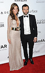 Alessandra Ambrosio and Jamie Mazur arriving to the amfAR Inspiration Gala held at Milk Studios in Los Angeles, Ca. December 12, 2013