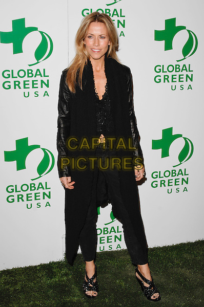 SHERYL CROW.The 6th Annual Global Green USA Pre-Oscar Party benefiting Green Schools held at Avalon in Hollywood, California, USA. .February 19th, 2009 .full length black trousers long jacket shoes .CAP/ROT.©Lee Roth/Roth Stock/Capital Pictures