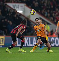Wolverhampton Wanderers' Raul Jimenez (right) vies for possession with Bournemouth's Nathan Ake (left) <br /> <br /> Photographer David Horton/CameraSport<br /> <br /> The Premier League - Bournemouth v Wolverhampton Wanderers - Saturday 23rd November 2019 - Vitality Stadium - Bournemouth<br /> <br /> World Copyright © 2019 CameraSport. All rights reserved. 43 Linden Ave. Countesthorpe. Leicester. England. LE8 5PG - Tel: +44 (0) 116 277 4147 - admin@camerasport.com - www.camerasport.com