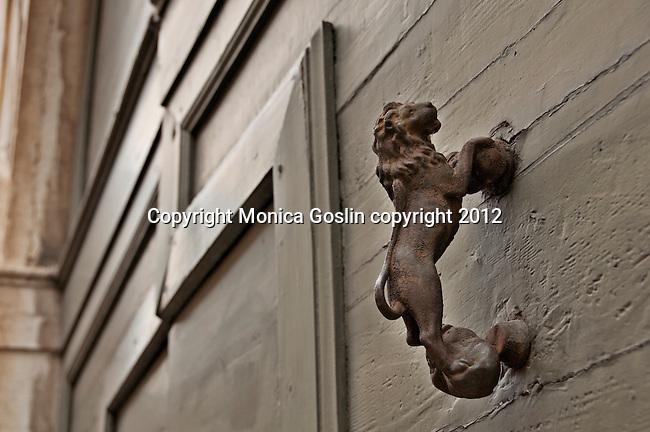 A lion door knocker in Brescia, Italy