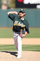 Danny Farquhar #63 of the Oakland Athletics pitches against the Cleveland Indians in a spring training game at Phoenix Municipal Stadium on March 2, 2011  in Phoenix, Arizona. .Photo by:  Bill Mitchell/Four Seam Images.