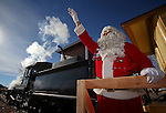 Santa waves at passing motorists while waiting for the Santa Train to leave the Nevada State Railroad Museum in Carson City, Nev., on Sunday, Dec. 1, 2013. <br /> Photo by Cathleen Allison