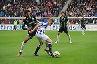VOETBAL: HEERENVEEN: Abe Lenstra Stadion, 21-10-2012, SC Heerenveen - FC Groningen, Einduitslag 3-0, Virgil van Dijk (#4  I GRON) Alfreð Finnbogason. (#11 | SCH), ©foto Martin de Jong