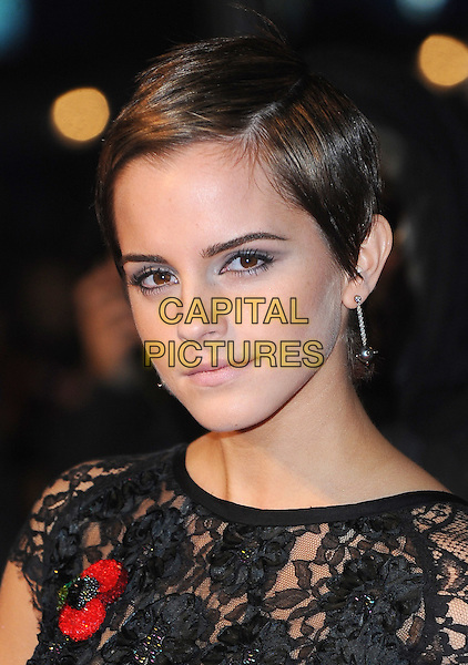 "EMMA WATSON .attending ""Harry Potter And The Deathly Hallows: Part 1"" World Film Premiere, Empire cinema Leicester Square and Odeon cinema Leicester Square, London, England, UK, .11th November 2010..portrait headshot  short crop cropped hair haircut make-up beauty dangly silver earrings  black lace  sheer see thru through poppy .CAP/BEL.©Tom Belcher/Capital Pictures."