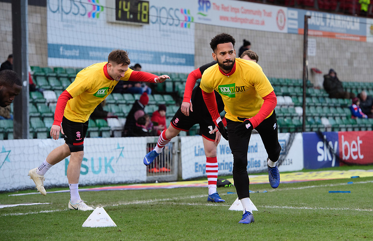 Lincoln City's Lee Frecklington, left, and Lincoln City's Jordan Roberts during the pre-match warm-up<br /> <br /> Photographer Chris Vaughan/CameraSport<br /> <br /> The EFL Sky Bet League Two - Lincoln City v Northampton Town - Saturday 9th February 2019 - Sincil Bank - Lincoln<br /> <br /> World Copyright &copy; 2019 CameraSport. All rights reserved. 43 Linden Ave. Countesthorpe. Leicester. England. LE8 5PG - Tel: +44 (0) 116 277 4147 - admin@camerasport.com - www.camerasport.com