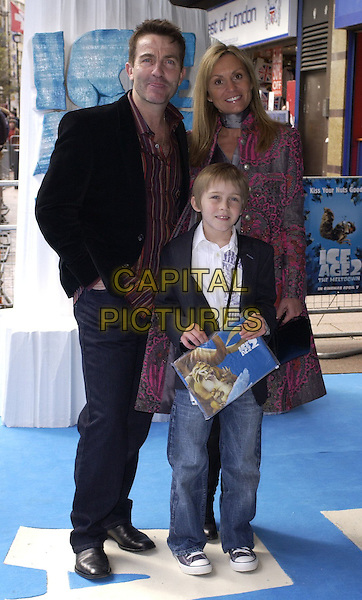 "BRADLEY WALSH & FAMILY.At the UK Film Premiere of ""Ice Age 2: The Meltdown"",.Empire Cinema, Leicester Square, London, .England, April 2nd 2006..full length wife? son child kid .Ref: CAN.www.capitalpictures.com.sales@capitalpictures.com.©Can Nguyen/Capital Pictures"
