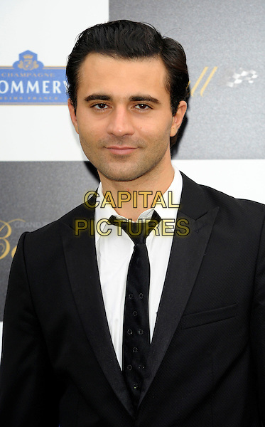 DARIUS CAMPBELL .Attending The Grand Prix Ball at The Hurlingham Club, London, England, UK, .7th July 2010..portrait headshot white shirt suit black tie .CAP/CJ.©Chris Joseph/Capital Pictures.