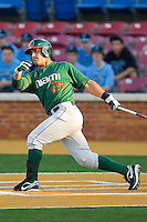 Rony Rodriguez #21 of the Miami Hurricanes follows through on his swing against the Wake Forest Demon Deacons at Gene Hooks Field on March 18, 2011 in Winston-Salem, North Carolina.  Photo by Brian Westerholt / Four Seam Images
