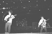 UNIONDALE, NY AUGUST 08,1987: Robert Smith and Simon Gallup of The Cure perform at Nassau Coliseum on August 8, 1987 in Uniondale NY. Photo By Larry Marano © 1987