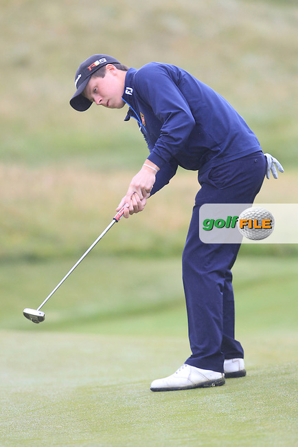 Mark MacGrath (Limerick) on the 5th green during Matchplay Semi Final of the South of Ireland Amateur Open Championship at LaHinch Golf Club on Sunday 26th July 2015.<br /> Picture:  Golffile | TJ Caffrey