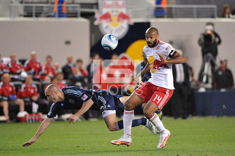 Thierry Henry (14) of the New York Red Bulls fouls Aurelien Collin (78) of Sporting Kansas City. The New York Red Bulls defeated Sporting Kansas City 1-0 during a Major League Soccer (MLS) match at Red Bull Arena in Harrison, NJ, on April 30, 2011.