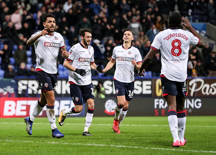 Bolton Wanderers' Josh Magennis celebrates scoring his side's second goal with team mates Will Buckley, Pawel Olkowski and Clayton Donaldson <br /> <br /> Photographer Andrew Kearns/CameraSport<br /> <br /> Emirates FA Cup Third Round - Bolton Wanderers v Walsall - Saturday 5th January 2019 - University of Bolton Stadium - Bolton<br />  <br /> World Copyright © 2019 CameraSport. All rights reserved. 43 Linden Ave. Countesthorpe. Leicester. England. LE8 5PG - Tel: +44 (0) 116 277 4147 - admin@camerasport.com - www.camerasport.com