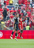 Philadelphia Union midfielder/forward Kyle Nakazawa #13 and Toronto FC midfielder Julian de Guzman #6 in action during an MLS game between the Philadelphia Union and the Toronto FC at BMO Field in Toronto on May 28, 2011..The Philadelphia Union won 6-2..