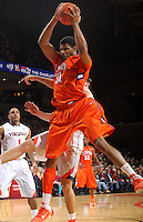 Clemson forward/center Devin Booker (31) grabs a rebound during the game against Virginia Thursday in Charlottesville, VA.