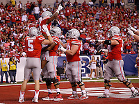 Ohio State Buckeyes offensive lineman Darryl Baldwin (76) lifts Ohio State Buckeyes running back Ezekiel Elliott (15) after scoring a 14-yard touchdown during the second quarter of the Big Ten Championship game against the Wisconsin Badgers at Lucas Oil Stadium in Indianapolis on Dec. 6, 2014. (Adam Cairns / The Columbus Dispatch)