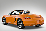 Rear three quarter view of a 2008 Porsche Boxster LE, with the top down
