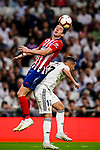 Filipe Luis of Atletico de Madrid (L) fights for the ball with Lucas Vazquez of Real Madrid (R) during their La Liga  2018-19 match between Real Madrid CF and Atletico de Madrid at Santiago Bernabeu on September 29 2018 in Madrid, Spain. Photo by Diego Souto / Power Sport Images