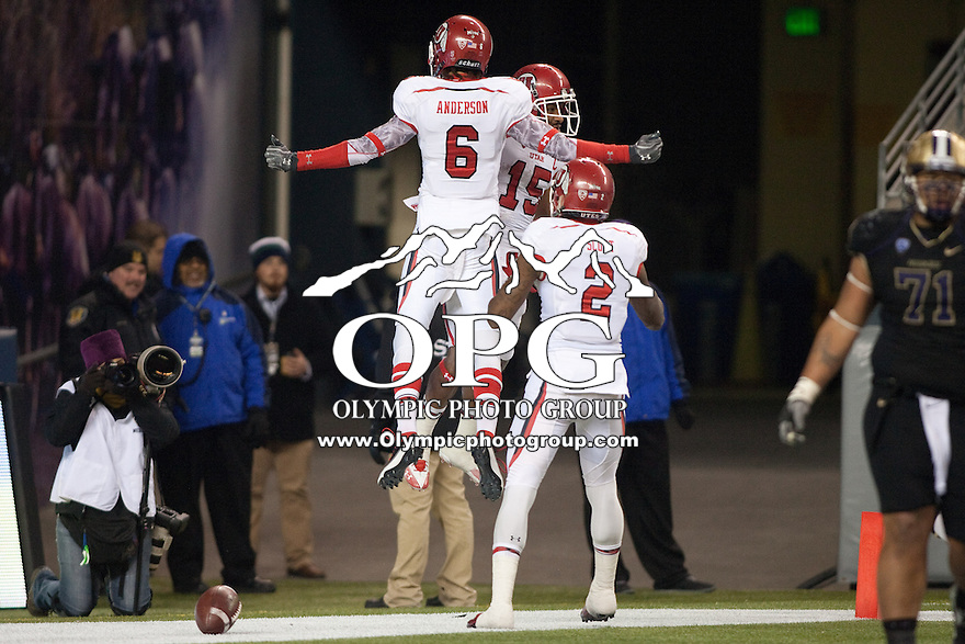 NOV 10, 2012:  Utah players #15 John White, #6 Drew Anderson and #2 Kenneth Scott celebrate in the endzone after White scored a touchdown.  Washington won 34-15 over Utah at CenturyLink Field in Seattle, WA...