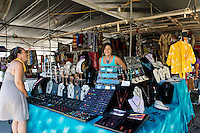 A local jewelry vendor at the Hilo Farmers Market on Mamo Street in downtown Hilo, Big Island of Hawai'i.