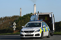 Pictured: Police at the area where climate protesters have blocked access to the Valero refinery in Pembroke Dock, Wales, UK. Thursday 19 September 2019<br /> Re: Ten Extinction Rebellion climate change protesters have blocked three entrances of the Valero site in Pembroke Dock, Pembrokeshire, one of the biggest oil refineries in Europe.<br /> Protesters have attached themselves to wooden boxes filled with concrete in a bit to stop vehicles from entering or leaving the site.