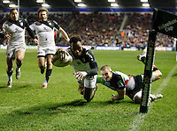 Photo: Richard Lane/Richard Lane Photography. Harlequins v Stade Toulouse. Heineken Cup. 09/12/2011. Toulouse's Timoci Matanavou dives in for a try.