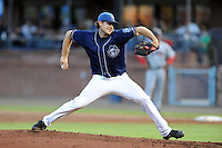 Asheville Tourists starting pitcher Matt Flemer #18 delivers a pitch during a game against the Hickory Crawdads at McCormick Field on August 22, 2013 in Asheville, North Carolina. The Tourists won the game 7-4. (Tony Farlow/Four Seam Images)