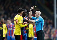 7th March 2020; Selhurst Park, London, England; English Premier League Football, Crystal Palace versus Watford; Referee Anthony Taylor giving a yellow card to Etienne Capoue of Watford