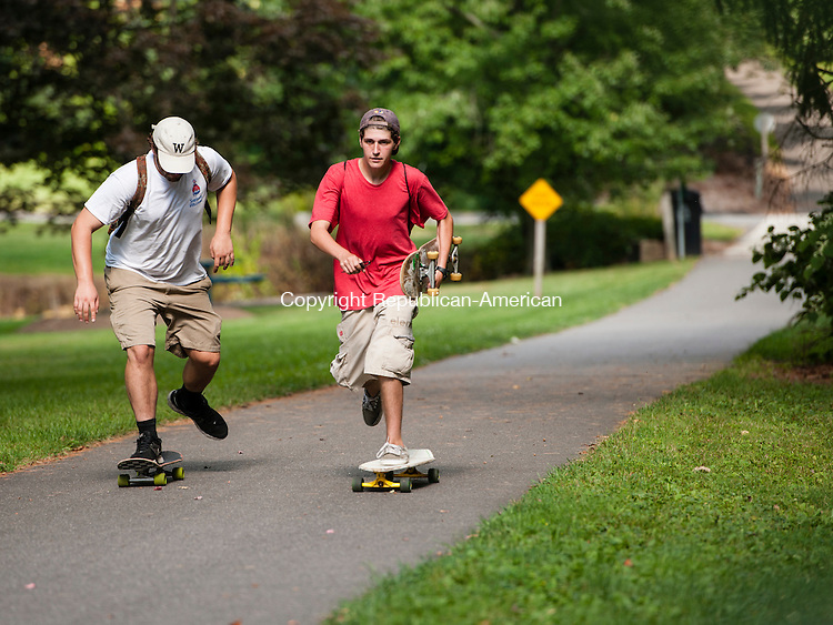 MIDDLEBURY, CT-2 September 2014-090214EC01-  Daniel Arnone (L) and Timothy Longino use the Middlebury Greenway Trail every day. They say it's much more biker and walker friendly than nearby towns. Erin Covey Republican-American