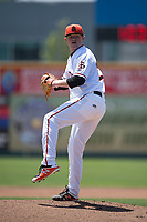 San Jose Giants starting pitcher Logan Webb (23) prepares to deliver a pitch during a California League game against the Lancaster JetHawks at San Jose Municipal Stadium on May 13, 2018 in San Jose, California. San Jose defeated Lancaster 3-0. (Zachary Lucy/Four Seam Images)
