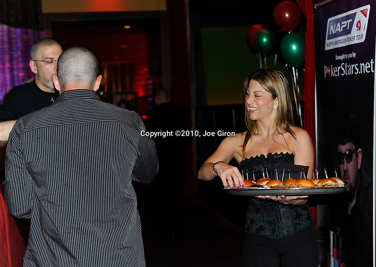 Waitresses present appetizers to the party attendees.
