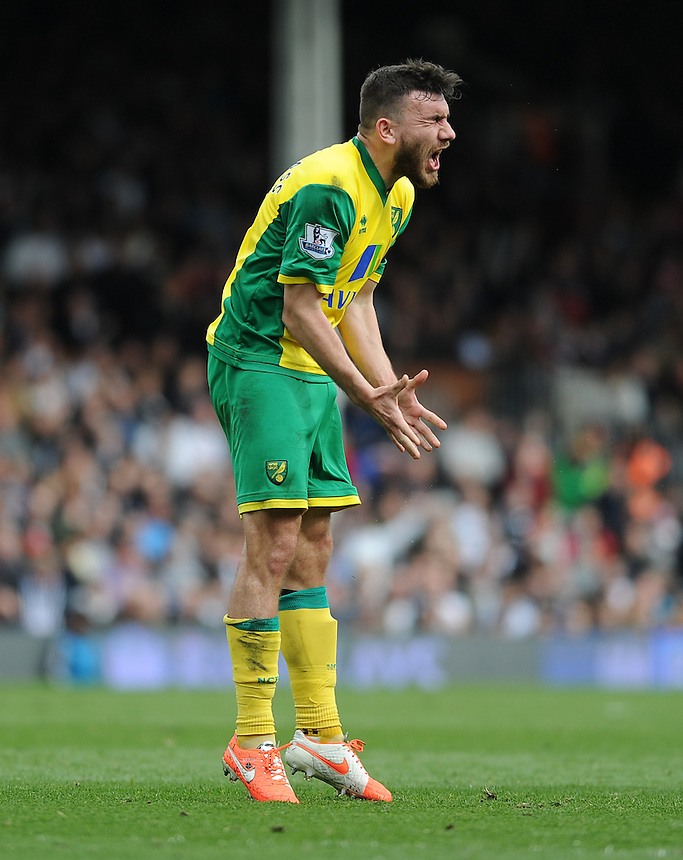 Norwich City's Robert Snodgrass after his free kick hit the bar<br /> <br /> Photo by Ashley Western/CameraSport<br /> <br /> Football - Barclays Premiership - Fulham v Norwich City - Saturday 12th April 2014 - Craven Cottage - London<br /> <br /> &copy; CameraSport - 43 Linden Ave. Countesthorpe. Leicester. England. LE8 5PG - Tel: +44 (0) 116 277 4147 - admin@camerasport.com - www.camerasport.com
