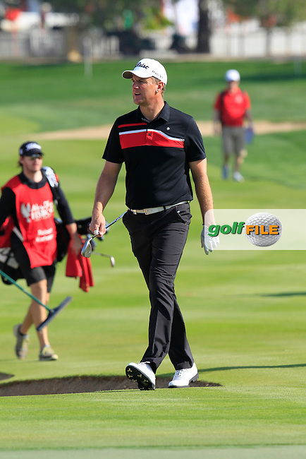 Robert Karlsson (SWE) walks to the 1st green during Friday's Round 2 of the Abu Dhabi HSBC Golf Championship 2015 held at the Abu Dhabi Golf Course, United Arab Emirates. 16th January 2015.<br /> Picture: Eoin Clarke www.golffile.ie