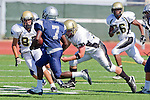Torrance, CA 09/08/11 - Michael Pettis (Peninsula #75), Jake Teren (Peninsula #85) and unidentified North players in action during the North-Peninsula Junior Varsity Football game at North High School in Torrance.
