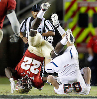 TALLAHASSEE, FL 11/19/11-FSU-UVA111911 CH-Florida State's Telvin Smith and Virginia's Jake McGee go head over heals on an Cavalier incomplete pass during first half action Saturday at Doak Campbell Stadium in Tallahassee. .COLIN HACKLEY PHOTO