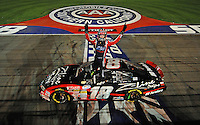 Aug 30, 2008; Fontana, CA, USA; NASCAR Nationwide Series driver Kyle Busch celebrates after winning the Camping World 300 at Auto Club Speedway. Mandatory Credit: Mark J. Rebilas-