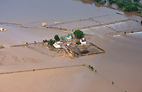 Flooding along South Platte River in Weld County, Colorado near Greeley.  Farmhouse