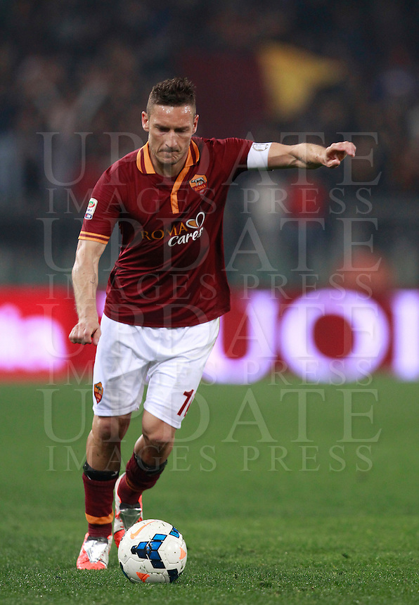 Calcio, Serie A: Roma vs Udinese. Roma, stadio Olimpico, 17 marzo 2014.<br /> AS Roma forward Francesco Totti in action during the Italian Serie A football match between AS Roma and Udinese at Rome's Olympic stadium, 17 March 2014.<br /> UPDATE IMAGES PRESS/Isabella Bonotto