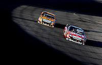 Nov. 16, 2008; Homestead, FL, USA; NASCAR Sprint Cup Series driver Carl Edwards (99) leads teammate Matt Kenseth during the Ford 400 at Homestead Miami Speedway. Mandatory Credit: Mark J. Rebilas-