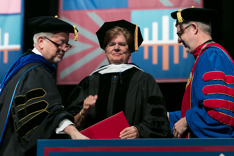 Sister Margaret Mary Fitzpatrick, S.C., president and CEO of St. Thomas Aquinas College in New York, receives an honorary degree Saturday, June 10, 2017, during the DePaul University College of Education commencement ceremony at the Rosemont Theatre in Rosemont, IL. (DePaul University/Jeff Carrion)